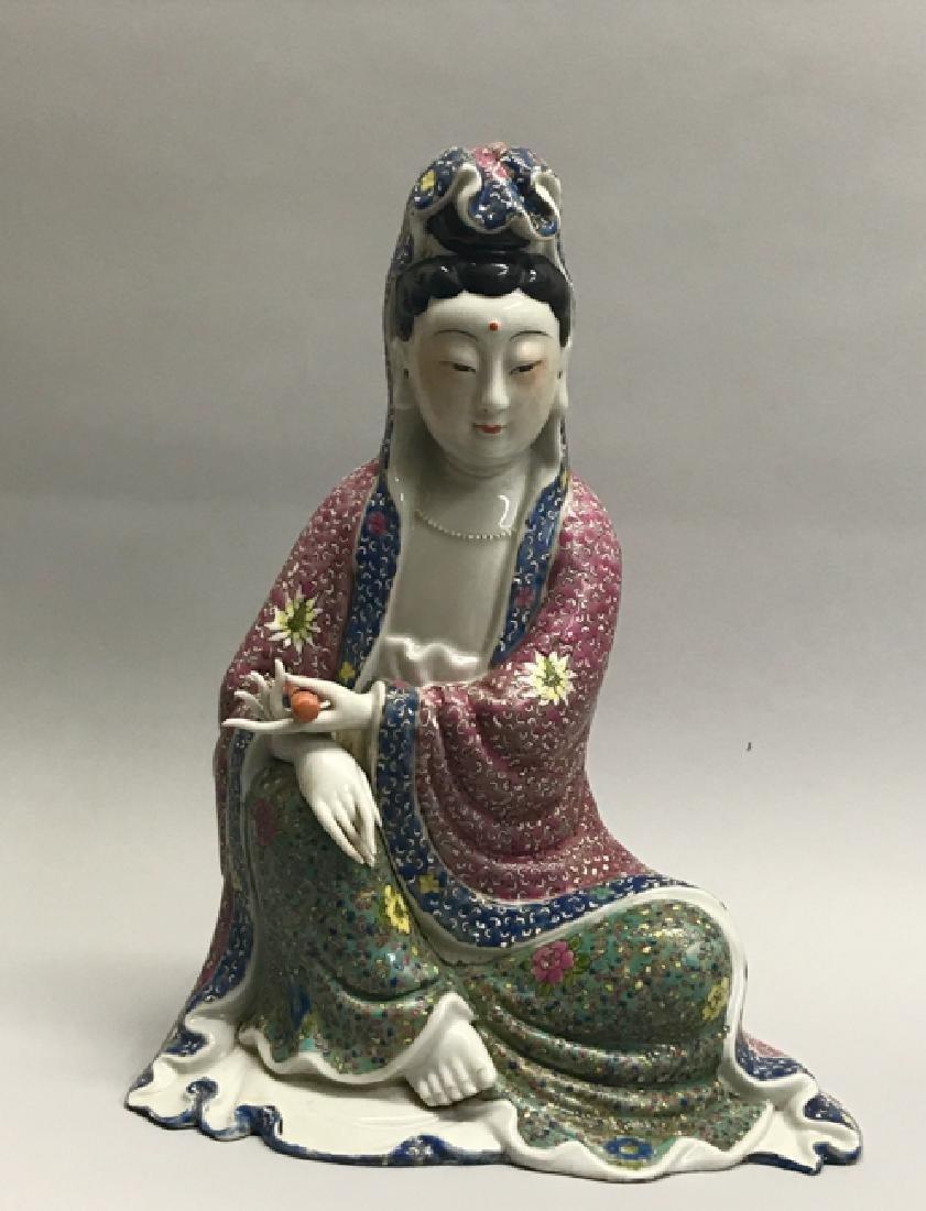 A famille rose figure of Guan yin