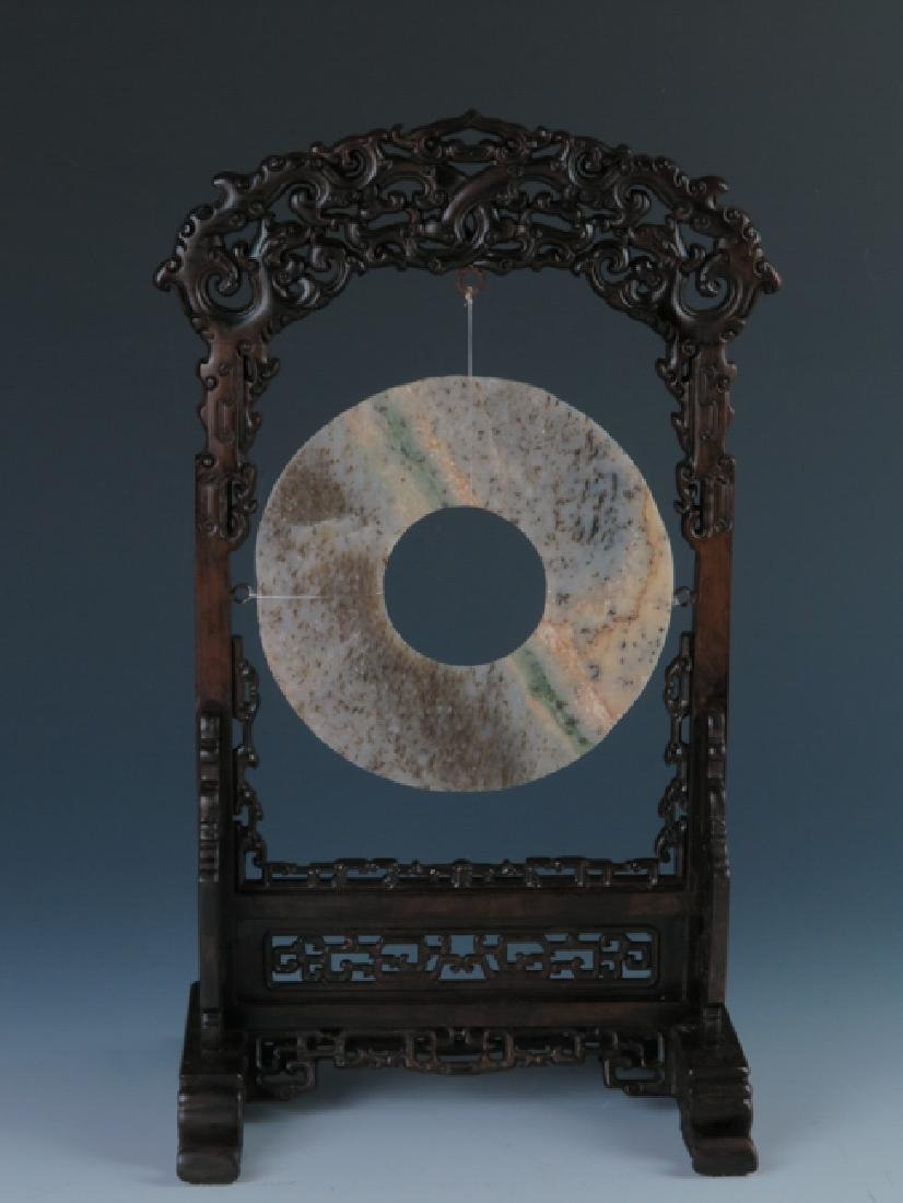 A jade disc with rose wood stand - 10