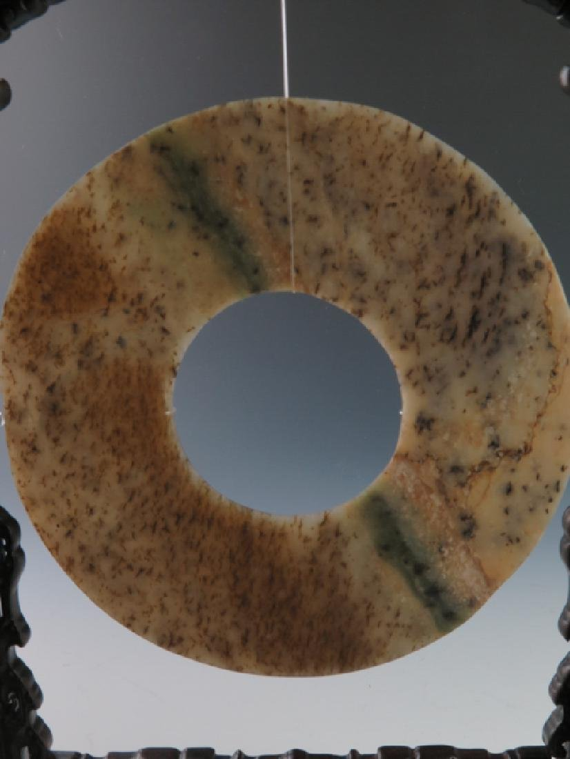 A jade disc with rose wood stand - 7
