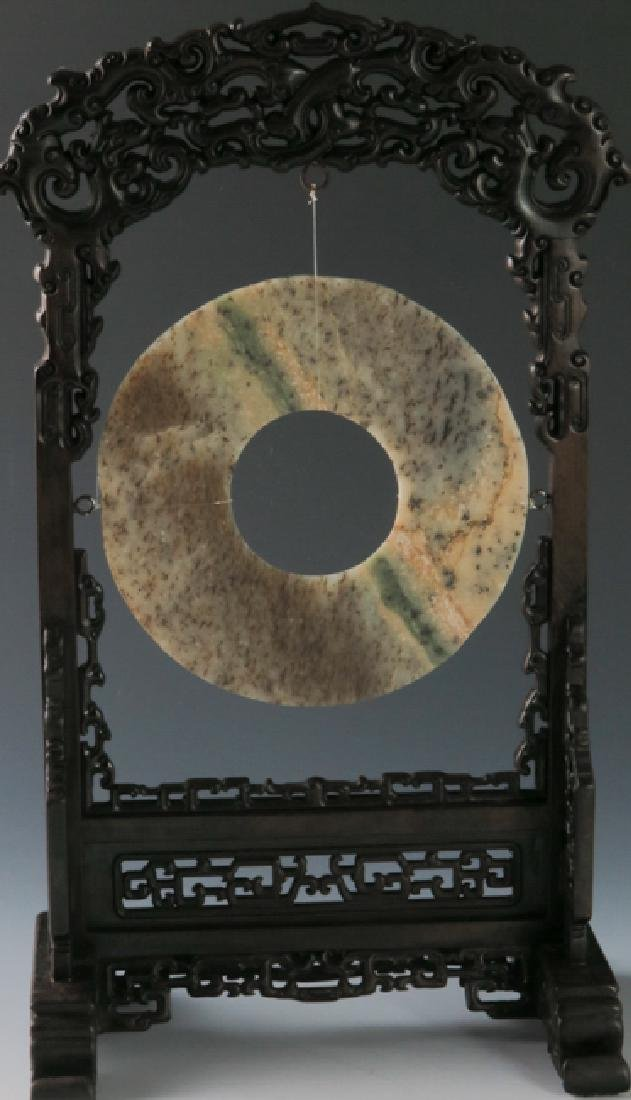 A jade disc with rose wood stand - 8