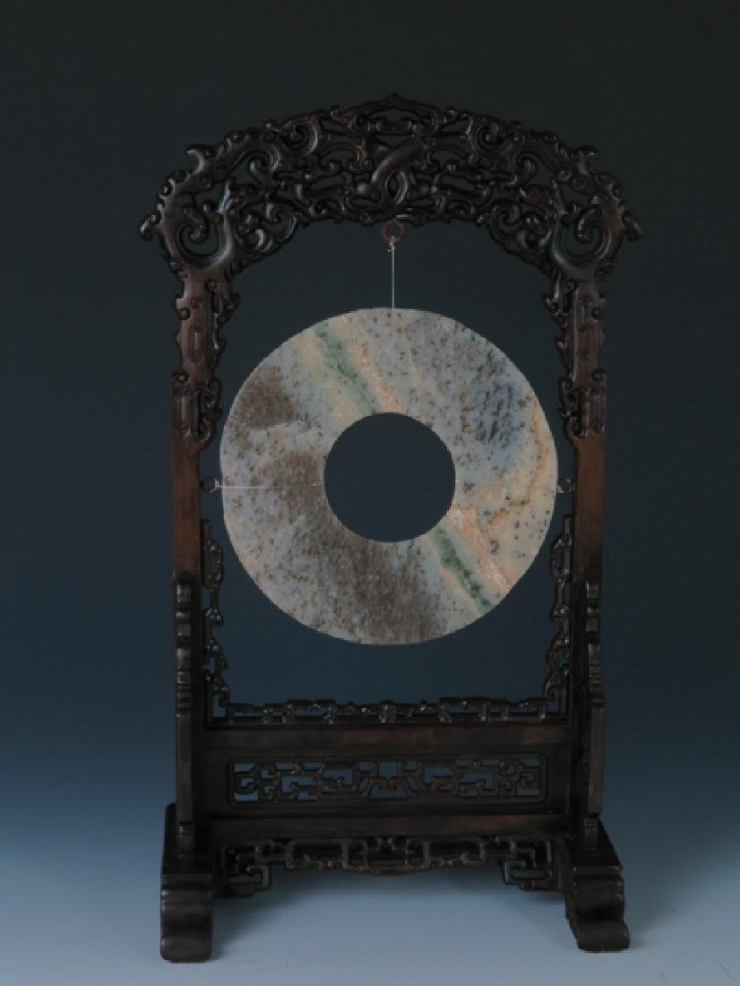 A jade disc with rose wood stand - 9