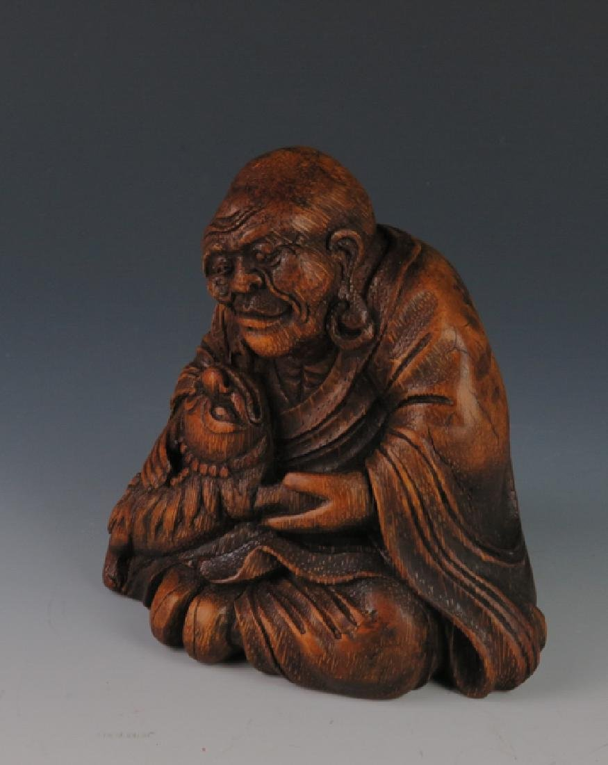 A carved bamboo figure - 2