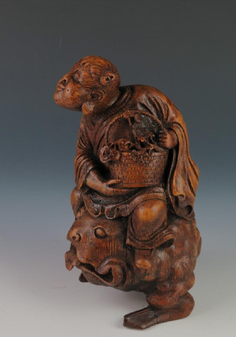 A carved bamboo figure - 10