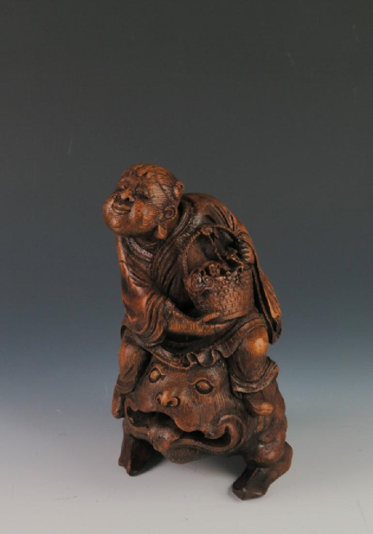 A carved bamboo figure
