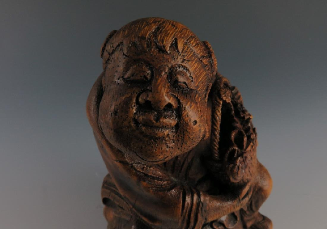 A carved bamboo figure - 4
