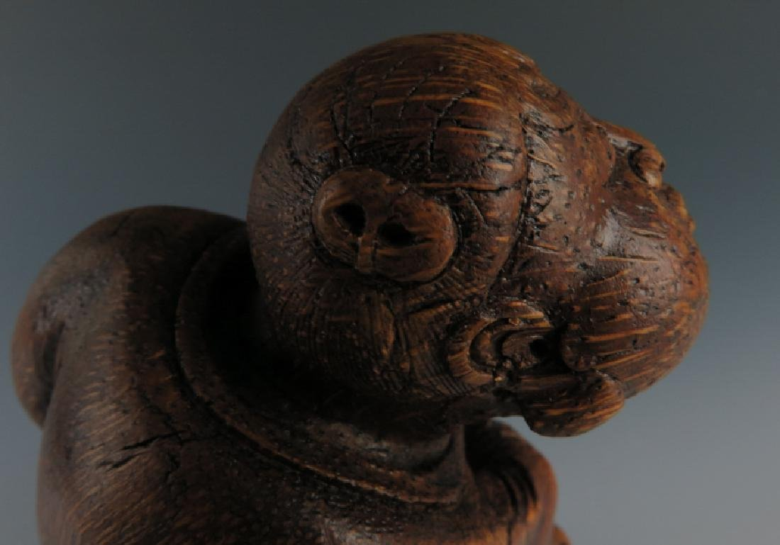 A carved bamboo figure - 5