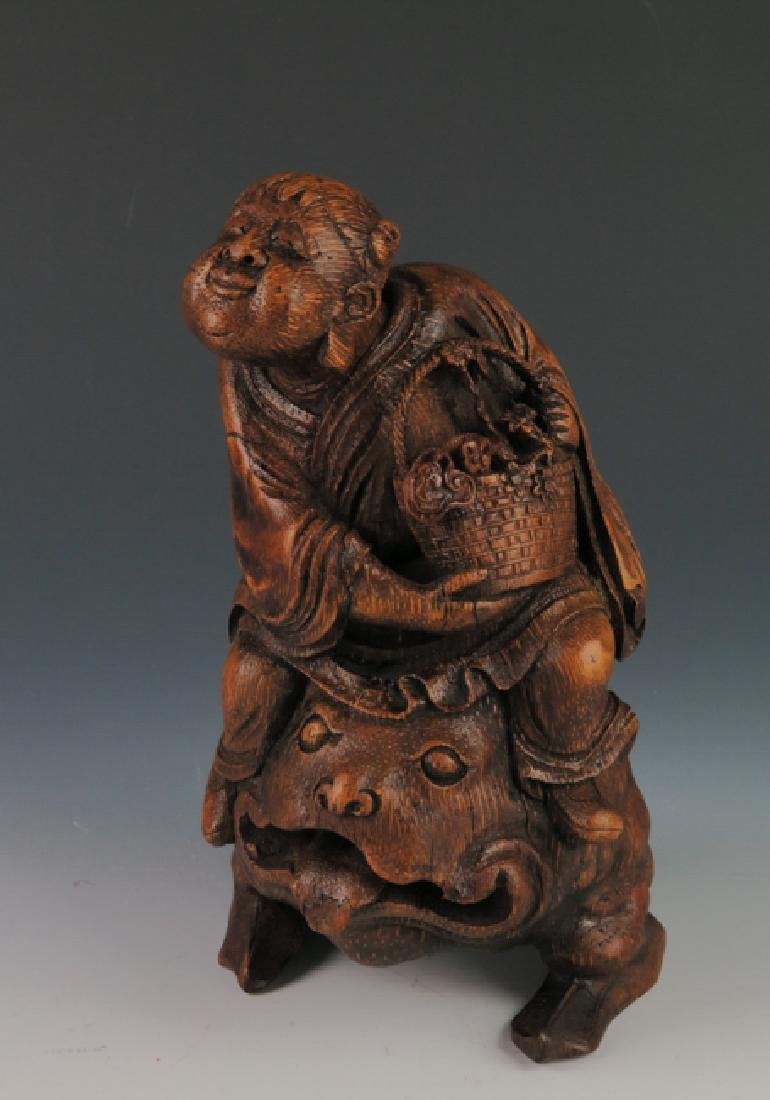 A carved bamboo figure - 7