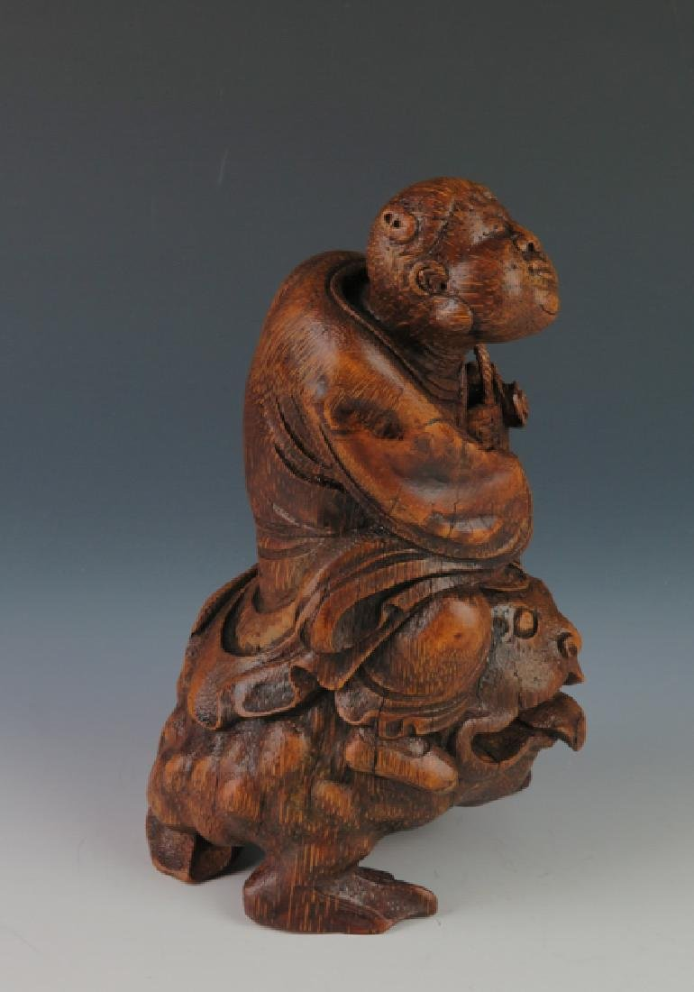 A carved bamboo figure - 9