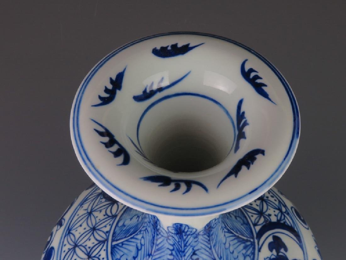 A blue and white vase - 9