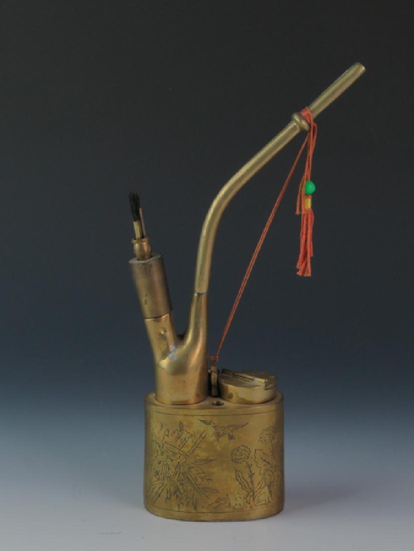 A bronze cigarette pipe - 3