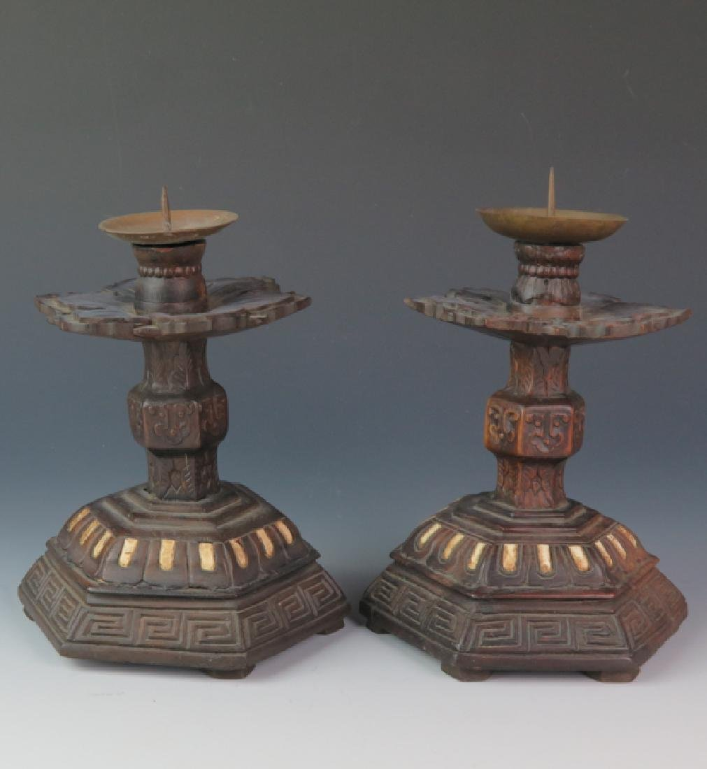 A pair of Wooden carved candle stick