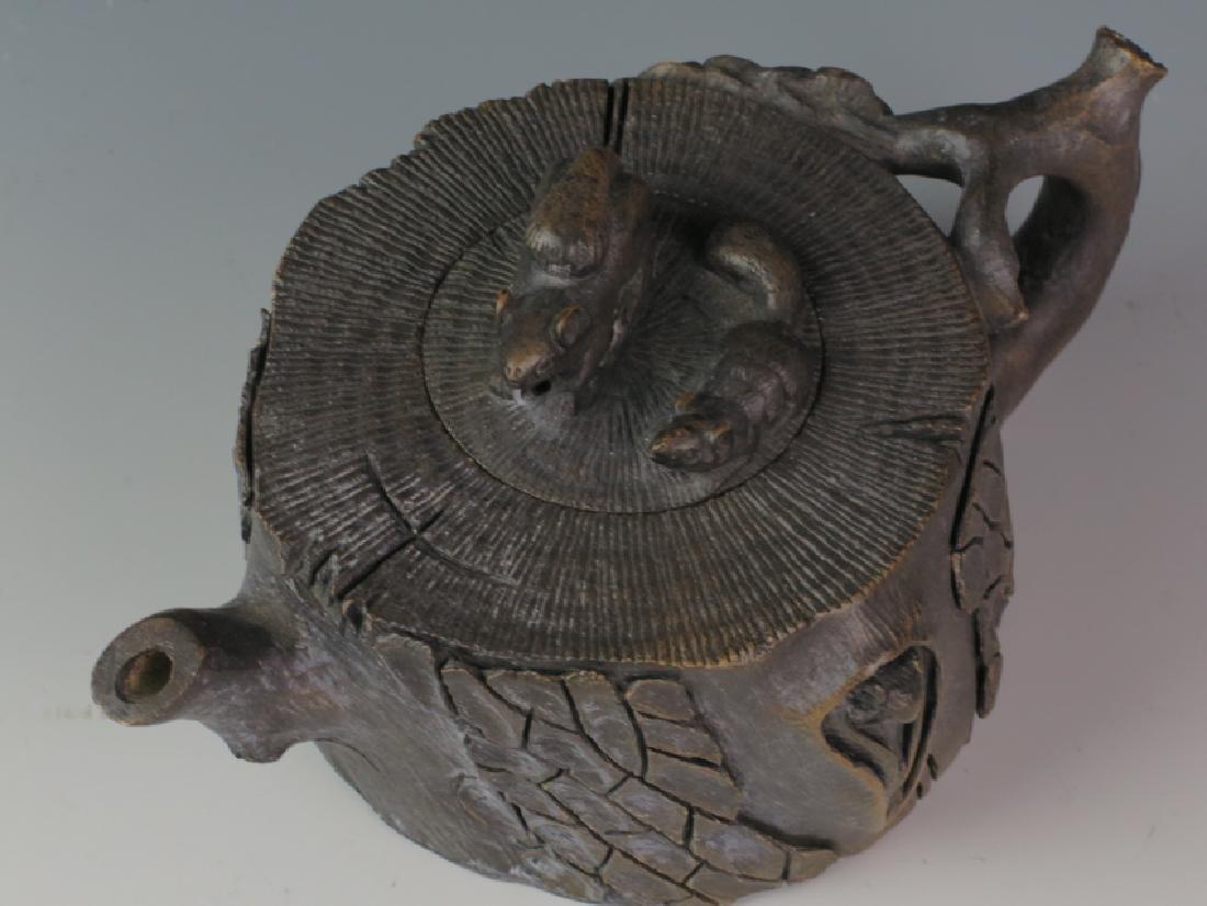 A stone tea pot - 3