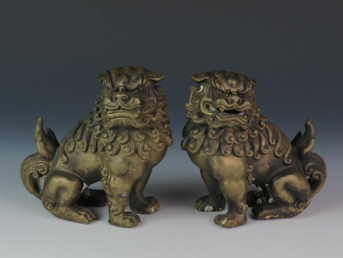 A pair of bronze lion