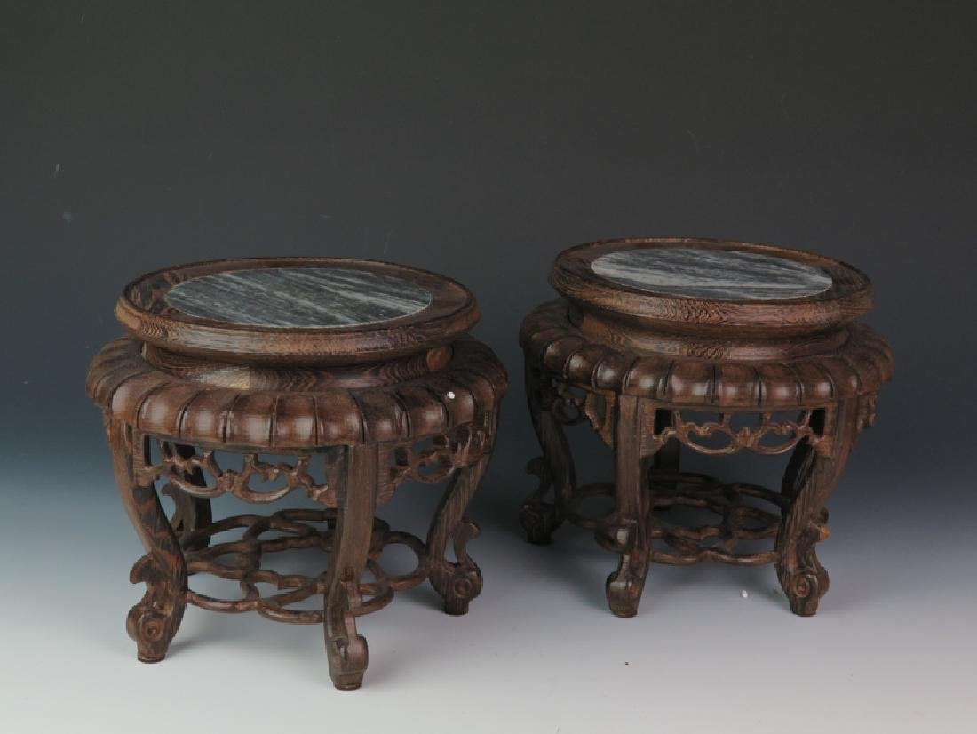 A pair of wooden marble stand