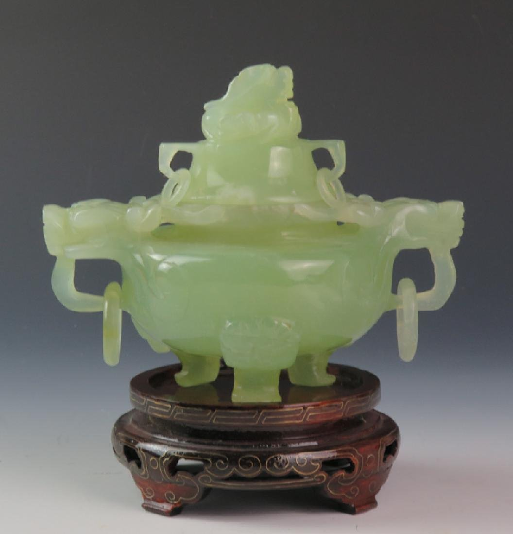 A jade incense burns