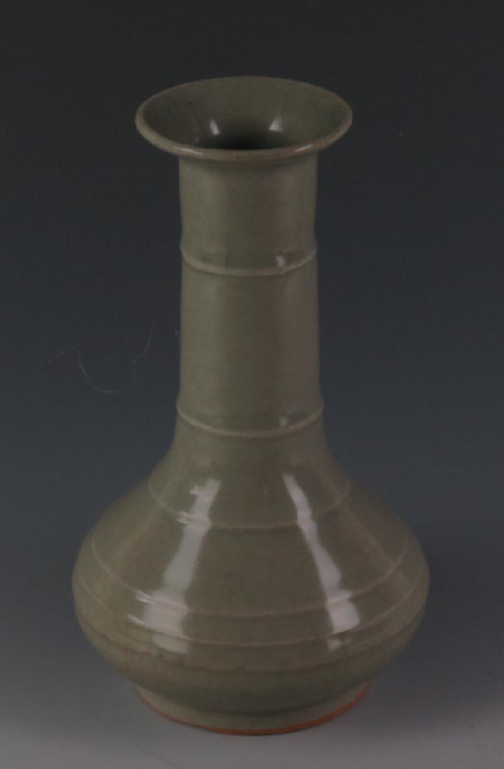 A long Quran  vase