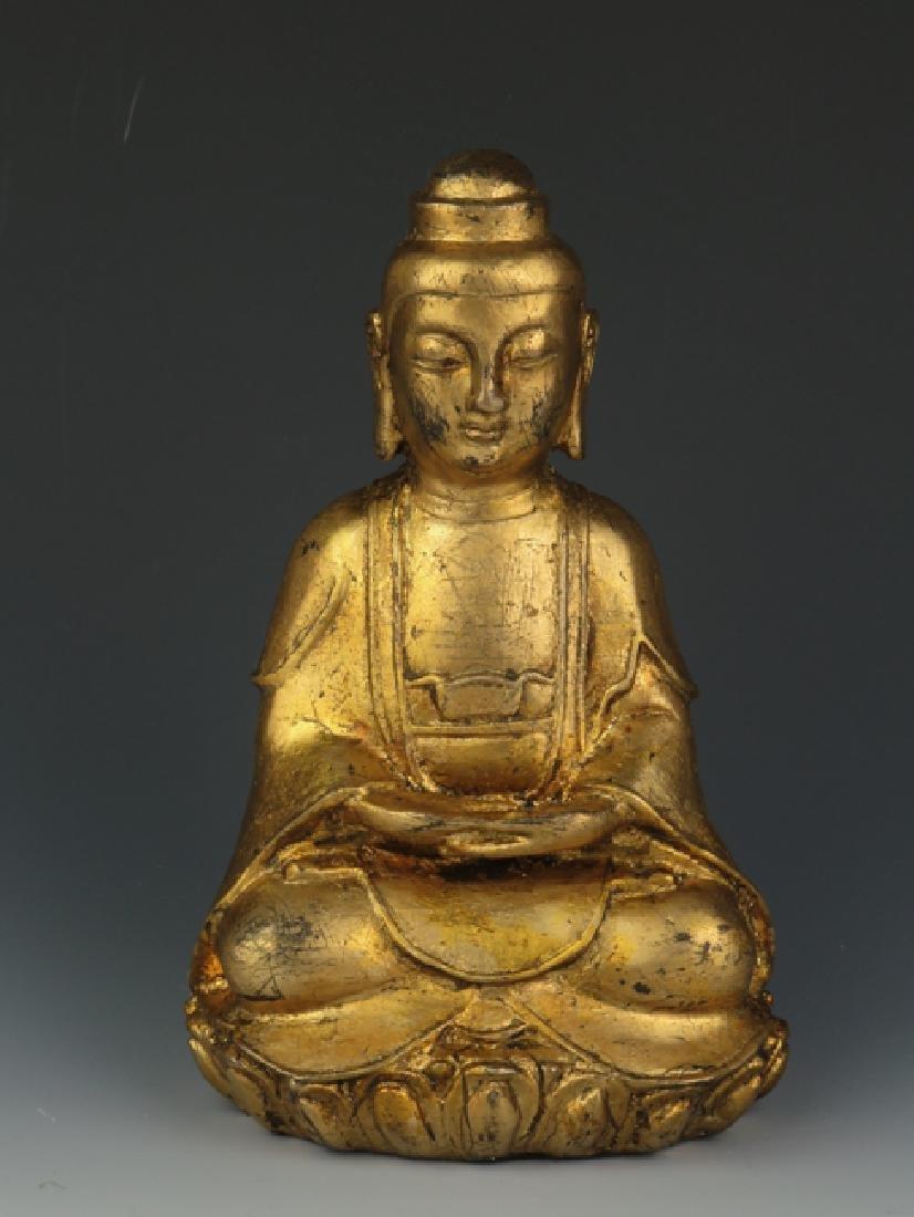 A gilt  bronze akshobhya