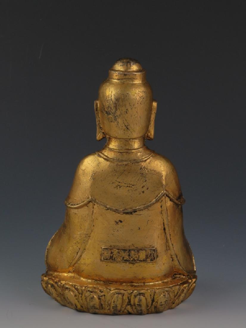 A gilt  bronze akshobhya - 2