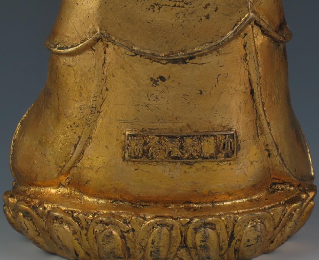 A gilt  bronze akshobhya - 3