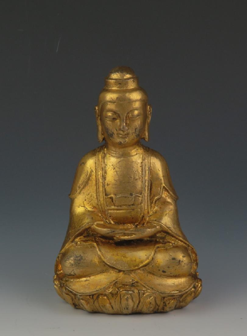 A gilt  bronze akshobhya - 4