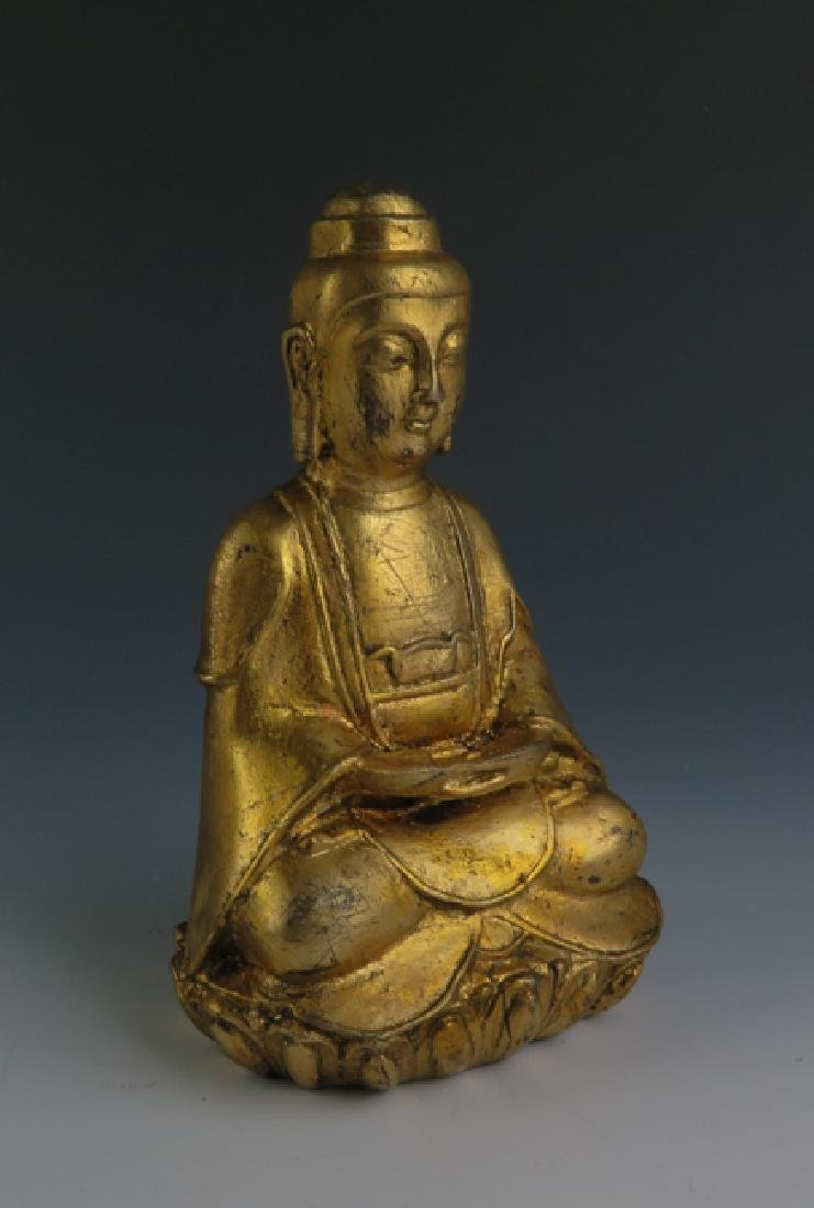 A gilt  bronze akshobhya - 5