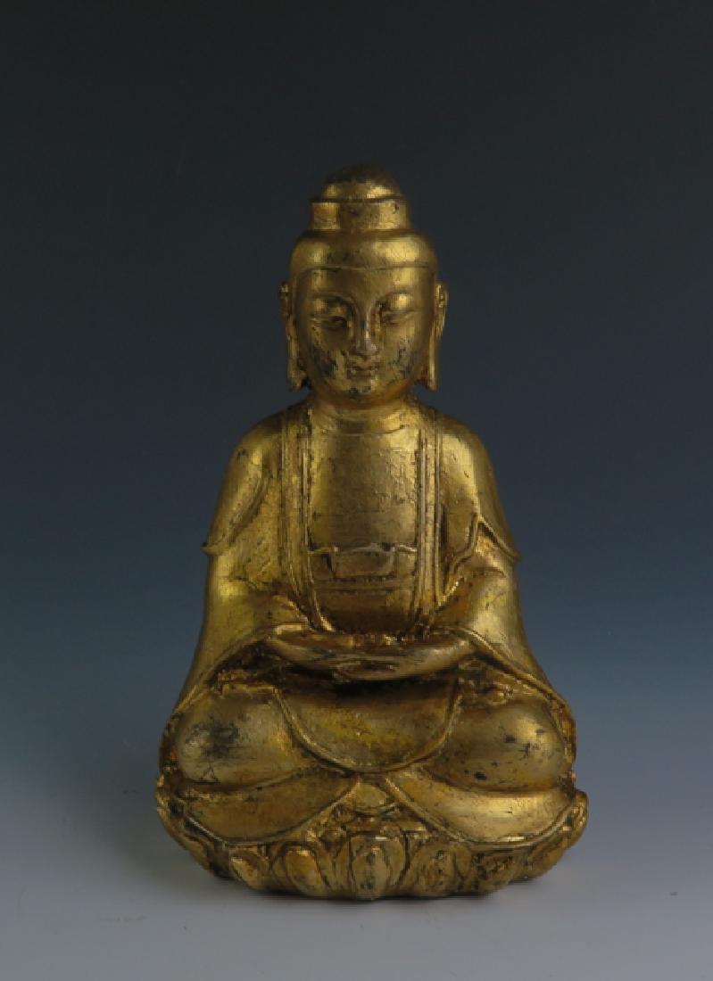 A gilt  bronze akshobhya - 6