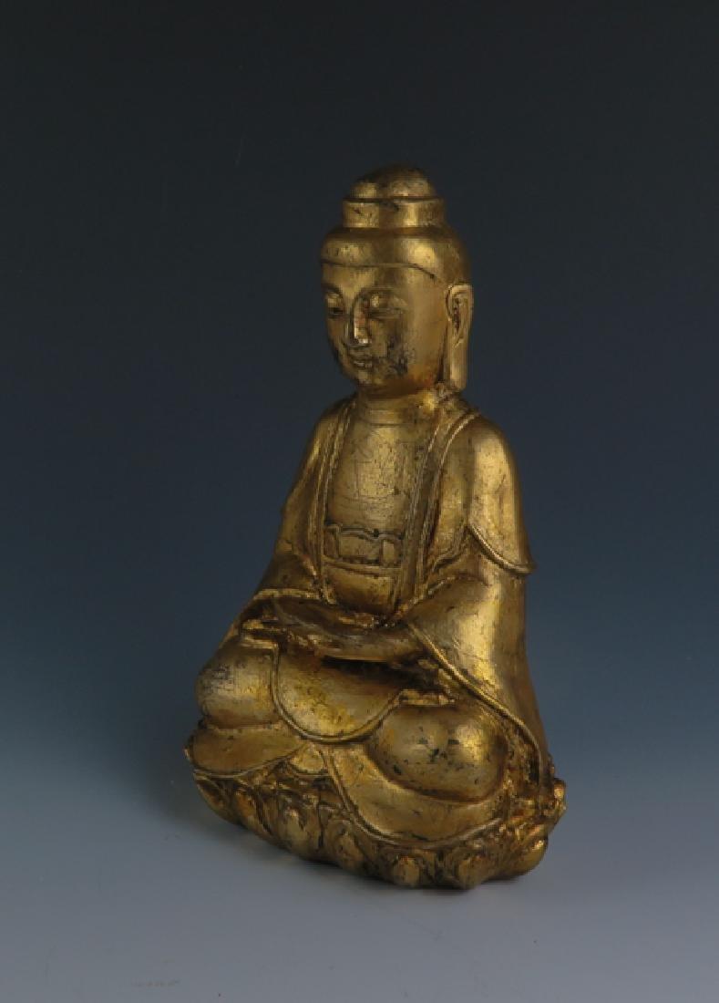 A gilt  bronze akshobhya - 7