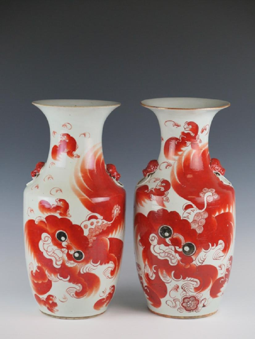A pair of iron-red decorated 'dragon' vases