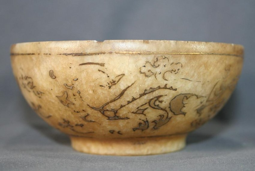 a jade bowl with inlay