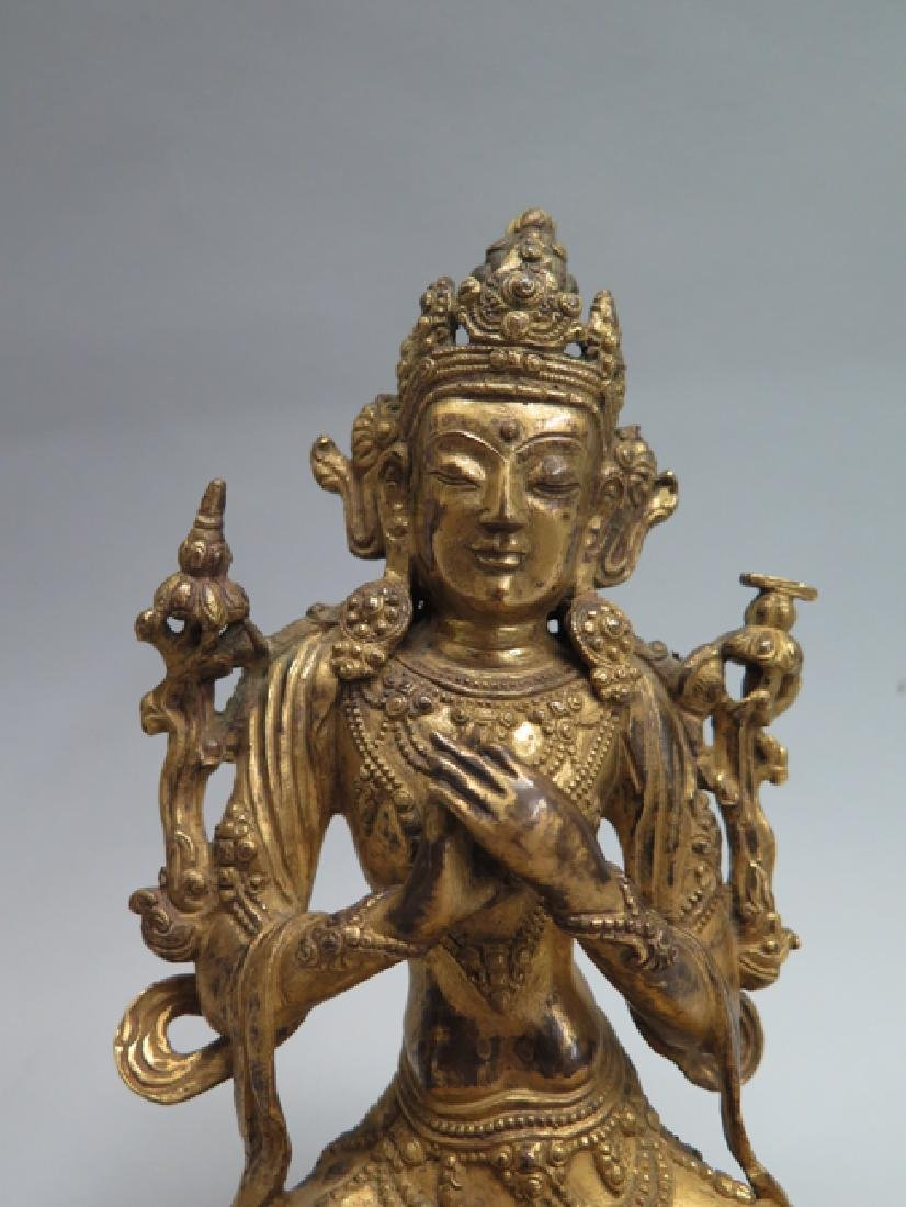A gilt bronze figure of Tara - 2