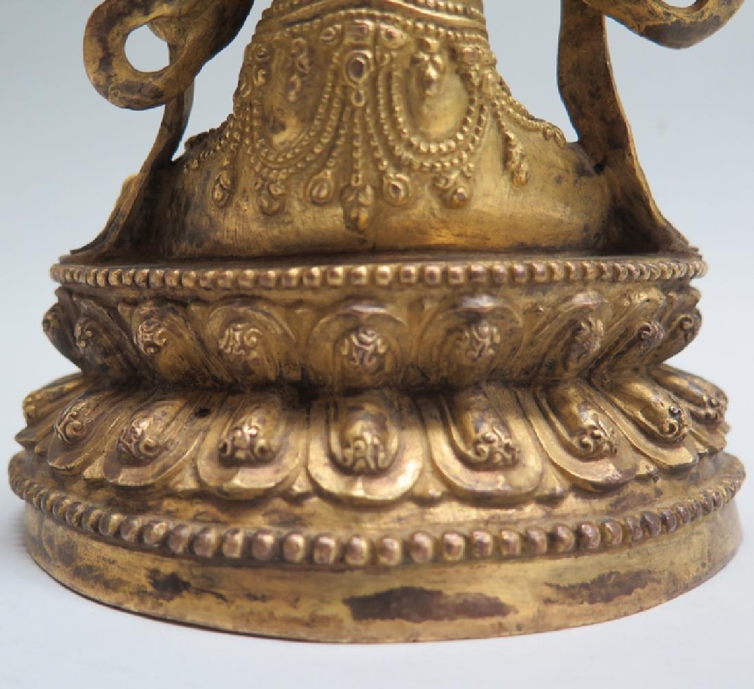 A gilt bronze figure of Tara - 7