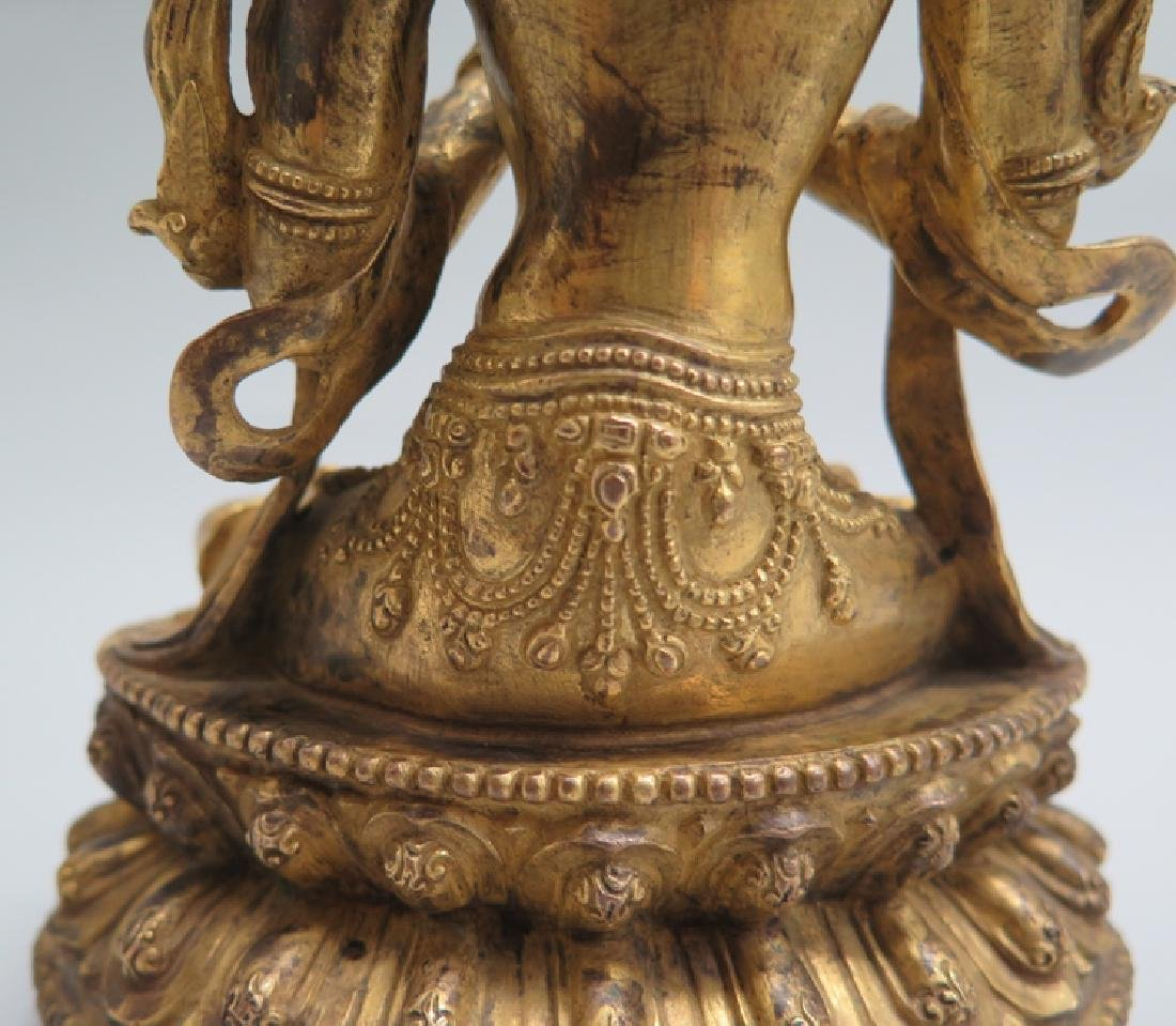 A gilt bronze figure of Tara - 8