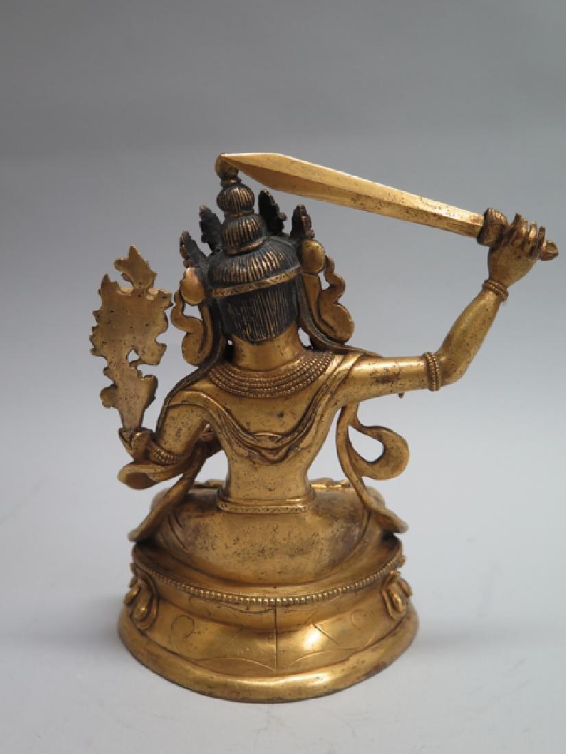 A gilt bronze figure of Manjushri - 10