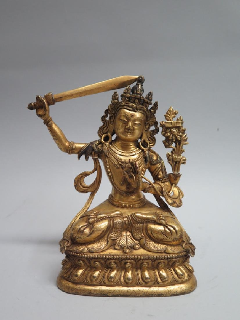 A gilt bronze figure of Manjushri - 2