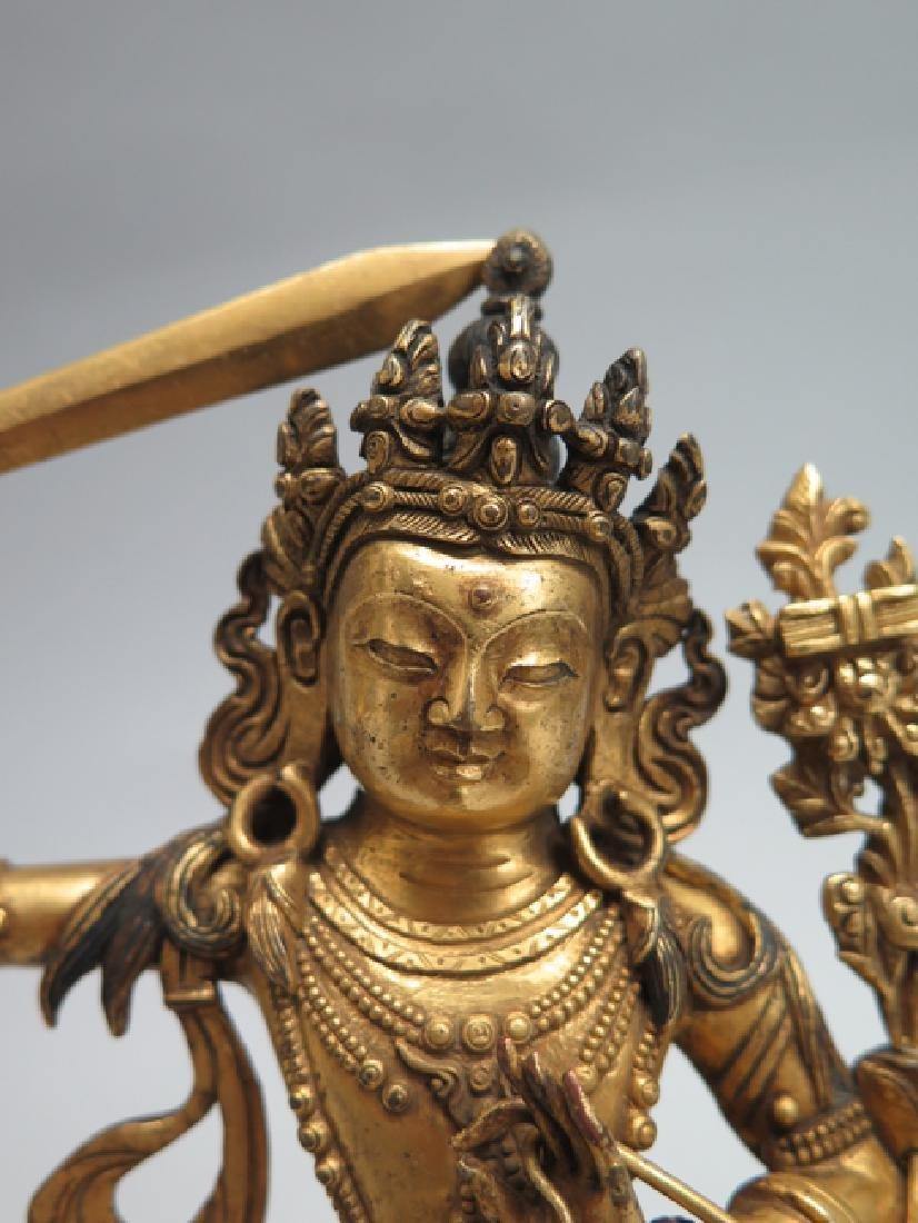 A gilt bronze figure of Manjushri - 3
