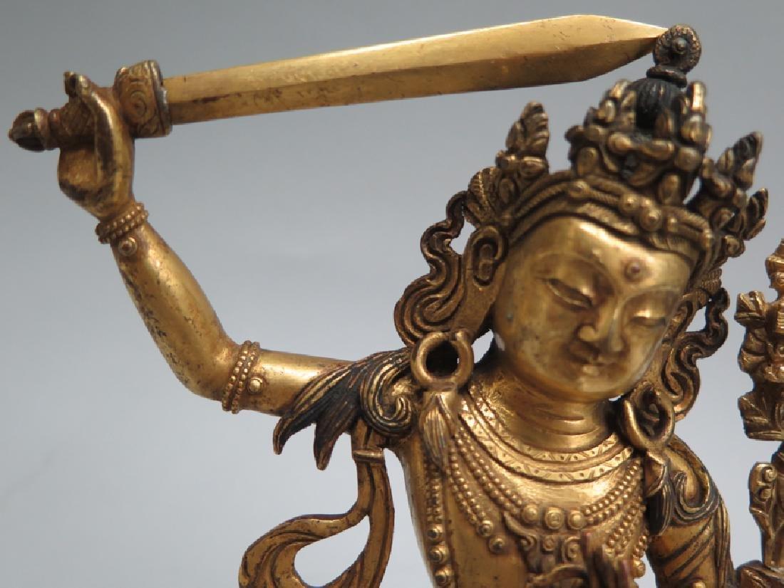 A gilt bronze figure of Manjushri - 6
