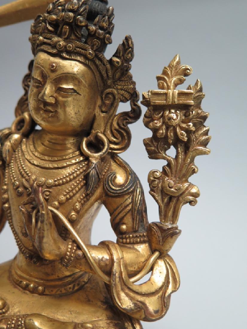 A gilt bronze figure of Manjushri - 7