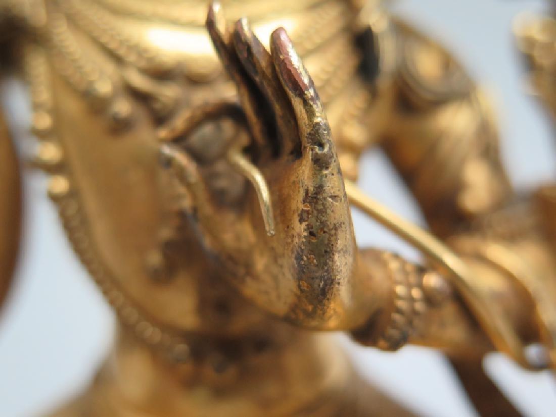 A gilt bronze figure of Manjushri - 8