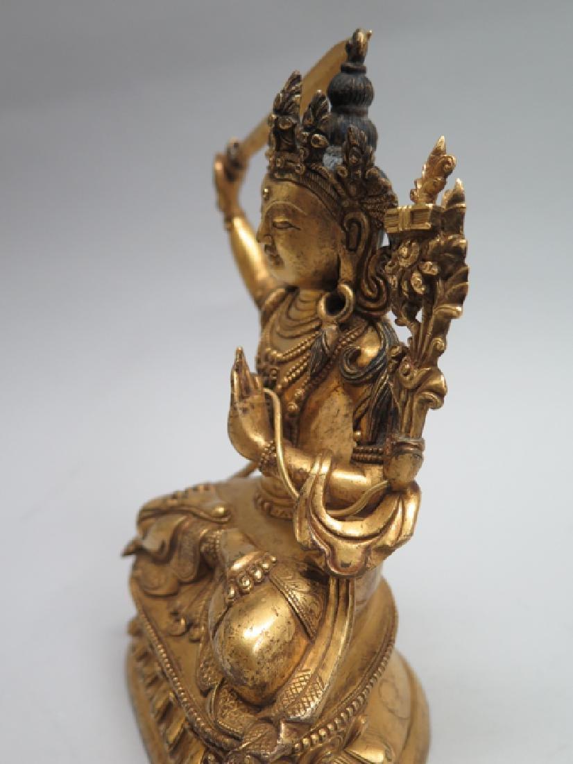 A gilt bronze figure of Manjushri - 9