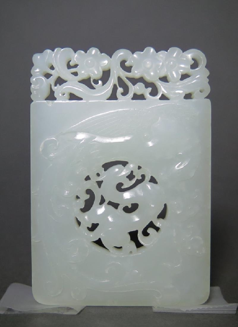 A craved white jade pendant