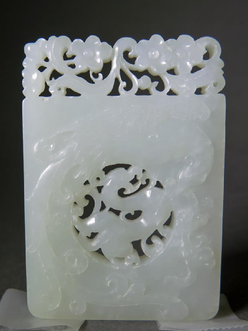 A craved white jade pendant - 2