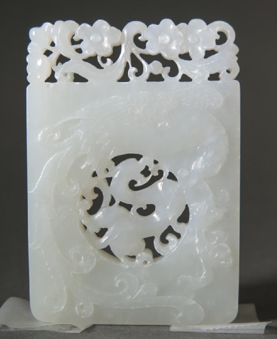 A craved white jade pendant - 3