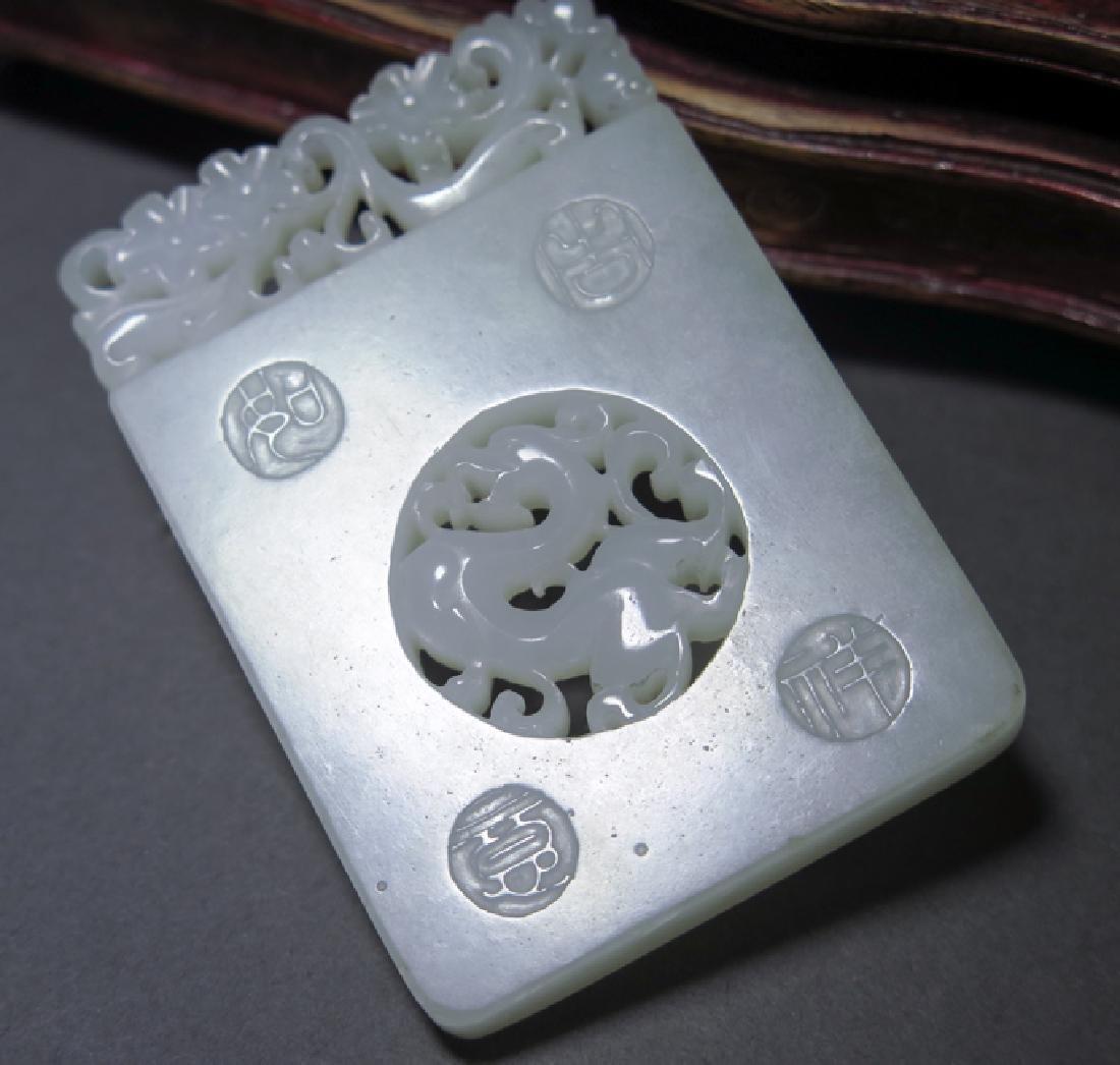 A craved white jade pendant - 5