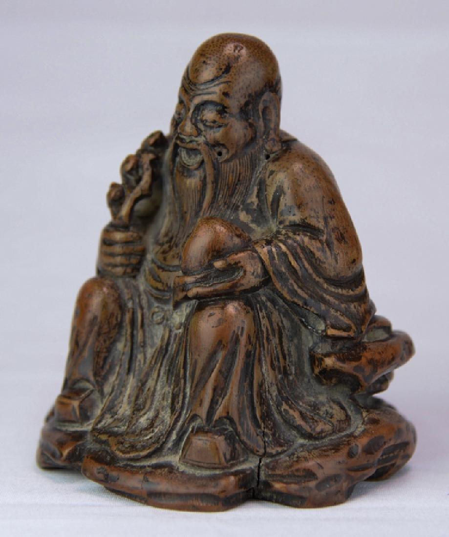 A wood figure of solau - 2