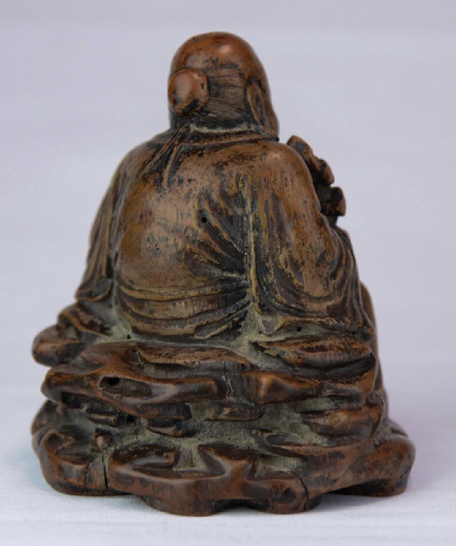 A wood figure of solau - 4
