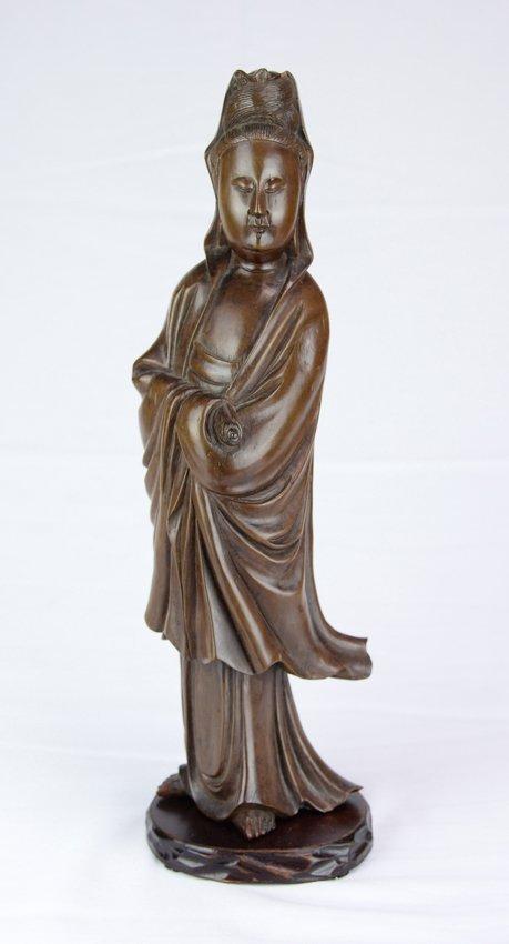 A Longyan wood Guanyin statue