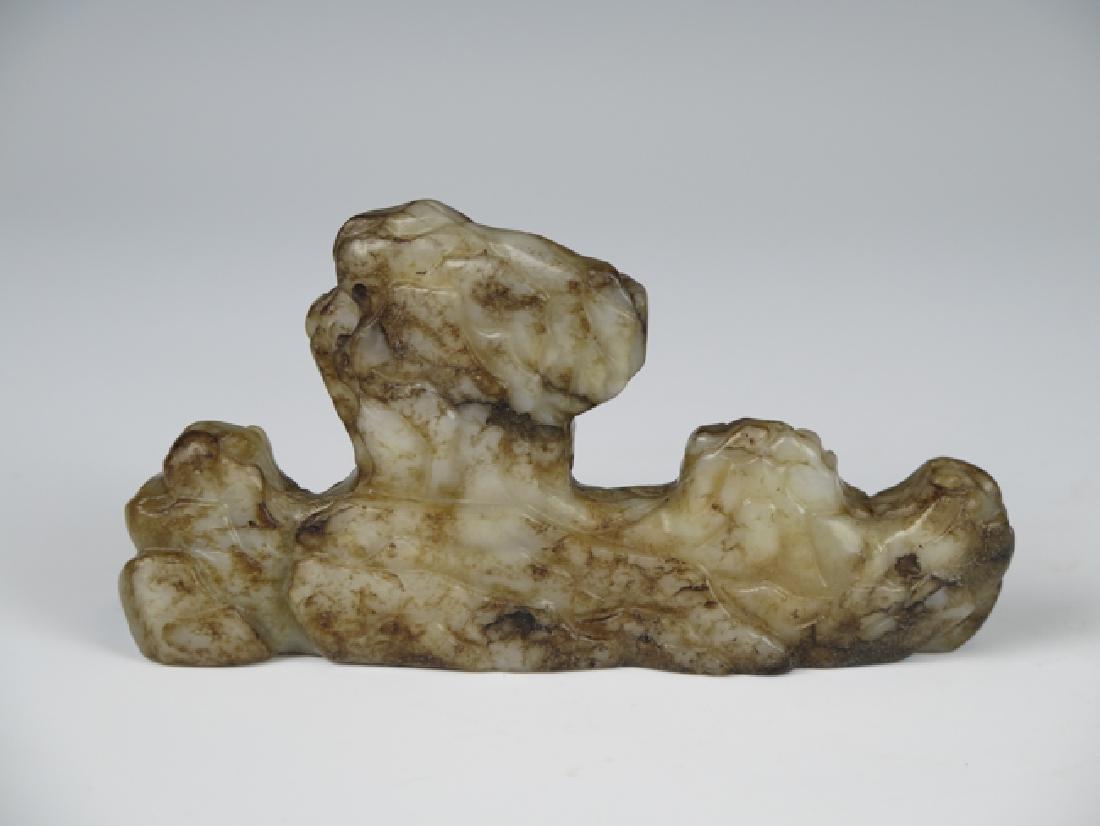 A jade brush holder