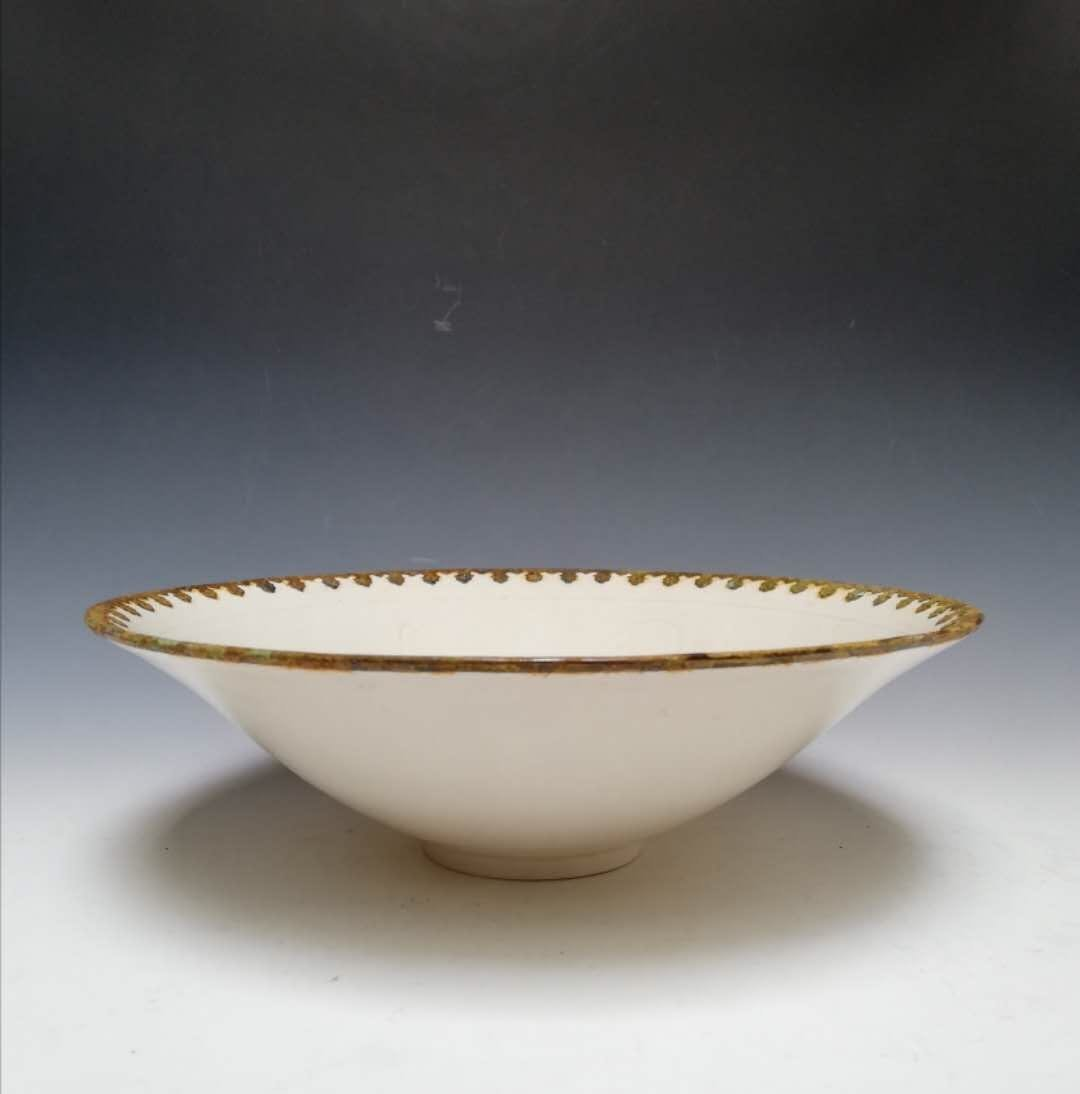 A Ding ware bowl mounted with metal edge