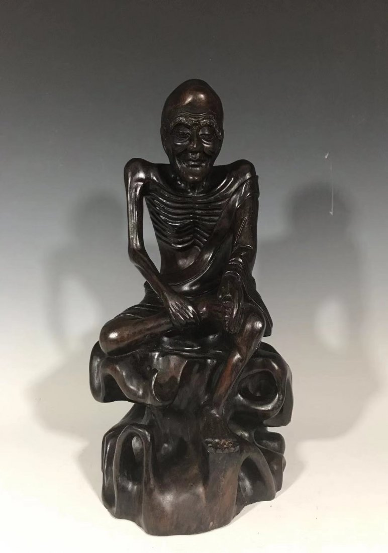 A fine carved of a hard wood figure Lohan
