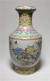 A famille-rose vase. Qianlong mark